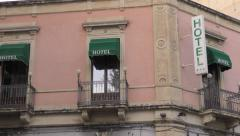 Hotel sign on sicilian hotel building at daytime. Stock Footage