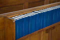 Church interior with Hymnals - stock photo