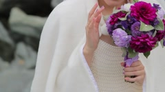 The bride considering a Bridal bouquet. Stock Footage
