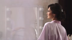 The girl looks in the mirror. Stock Footage