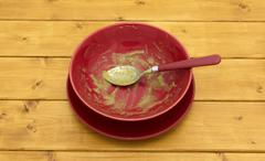 Empty soup bowl with remainder of soup Stock Photos
