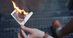 Beautiful sad woman burning photograph of her ex-boyfriend lover Stock Footage