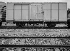 Cargo train and wooden track Stock Photos