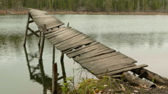 Broken old Bridge in the Forest Lake. Autumn daytime. Smooth dolly shot. Stock Footage