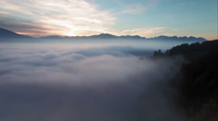 4K aerial flight over the mist - sunset & breathtaking view of the swiss Alps Stock Footage