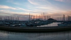 A harbour view at sunset. Yacht marina with night illumination. 4k, Time lapse Stock Footage