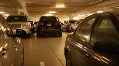 Car backing up in underground parking Stock Footage