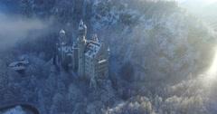 Aerial view of Neuschwanstein Castle at sunrise in winter landscape Stock Footage