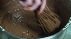 Mixture of chocolate and egg snow ingredients with a whisk Stock Footage