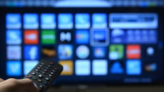 Smart tv and hand pressing remote control. Stock Footage