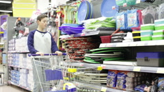Teen boy in the store takes a sledge with handles Stock Footage