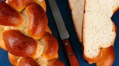 Cutted golden challah Stock Footage