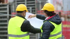 Back turned technician and architect at construction site - stock footage