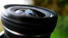 Camera Lens Reflecting Sky Stock Footage