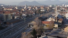 Train driving on tracks in Ljubljana city. Stock Footage