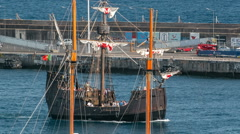 Replica ot vessel Santa Maria is passing the port of Funchal timelapse Stock Footage