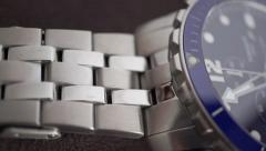 Polished steel watch wristlet macro dolly shot - stock footage