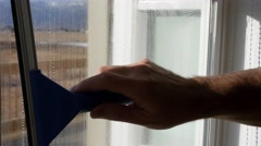 Man cleaning the house windows during the day Stock Footage