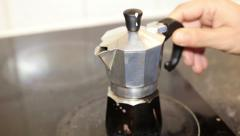 Moka Pot, italian traditional coffee maker, on a induction stove. Good morning s Stock Footage
