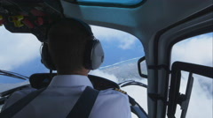 4K Helicopter Pilot flying through the clouds Stock Footage