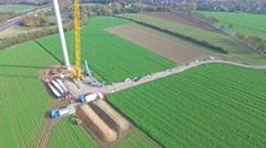 Huge crane building a wind power generator Stock Footage