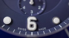 Blue clock dial of swiss made chronograph. Macro dolly shot - stock footage