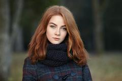 Stock Photo of Outdoors portrait of young beautiful redhead woman cold season