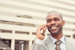 headshot handsome happy laughing young business man talking on mobile phone - stock photo