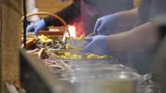 Christmas Fair street food market - grilled sausages mushrooms and potatoes Stock Footage