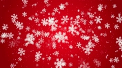 White snow flakes falling on red Stock Footage