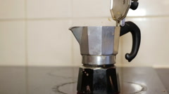 Italian coffee sprinkling out of a moka pot, italian traditional coffee maker, o Stock Footage