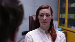 Woman in dental chair talking to a doctor Stock Footage
