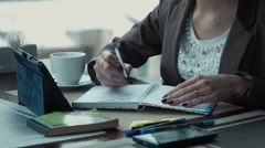 The freelancer girl works in cafe Stock Footage