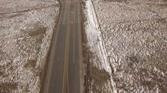 Aerial drone cars driving by winter fresh snow road landscape. - stock footage