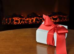 Gift and fireplace Stock Photos