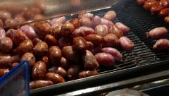 Short chinese sausages on grill grate, cook in progress, close up - stock footage