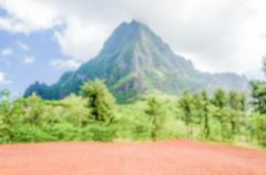 Defocused background of Tropical Mountain with vegetation, French Polynesia - stock photo