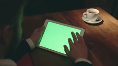 Drinking coffee tea close up of business man's hand using green screen tablet Stock Footage