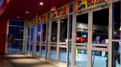 Close up door of people leaving and coming the movie theater Stock Footage