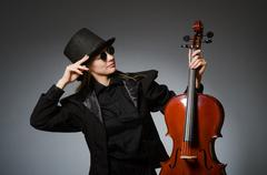 Woman playing classical cello in music concept Kuvituskuvat