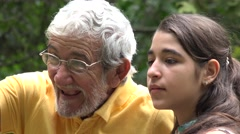 Grandfather and Granddaughter Having Fun Stock Footage