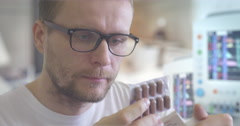 Young Man in Glasses is Taking Medicine Pills Capsules From Blister Drinks Stock Footage