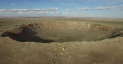 Aerial shot pulling away from Meteor Crater Stock Footage