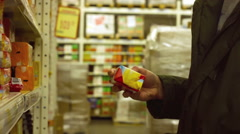 Man choose products in the hypermarket - stock footage