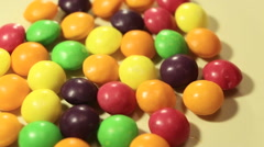Multicolor bonbon sweets (ball candies) rotating food background, closeup view Stock Footage