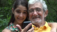 Grandfather and Granddaughter Selfie Stock Footage