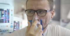 Young Man is Breathing Through Nebulizer Mask Parameters Displayed on the Stock Footage