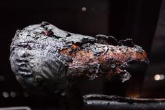 Burned bicycle saddle - stock photo