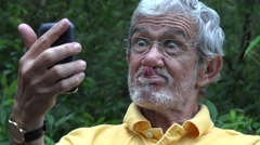 Elderly Old Man Taking Selfie Stock Footage