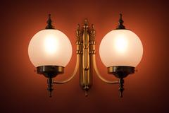 Symmetrical lamp on the wall Stock Photos
